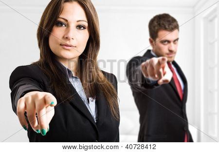 Business people pointing their fingers at you