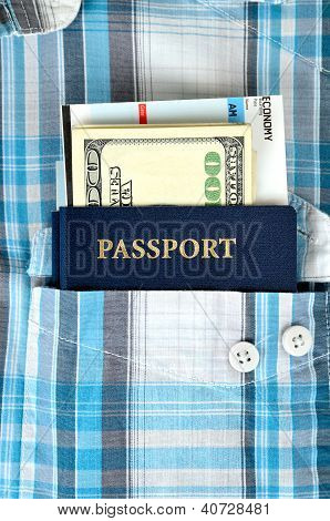 Passport, Money And Boarding Pass In A Pocket Of Shirt