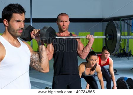 gym group with weight lifting bar and dumbbells workout in exercise