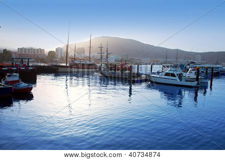 Los Cristianos harbor port sailboat sunrise in Adeje coast Arona Tenerife
