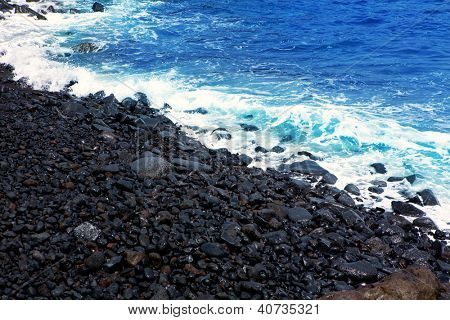 Atlantic volcanic black coast in la Palma with foam in funecaliente Canary Islands