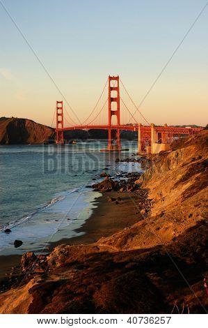 Golden gate bridge from Baker beach at sunset