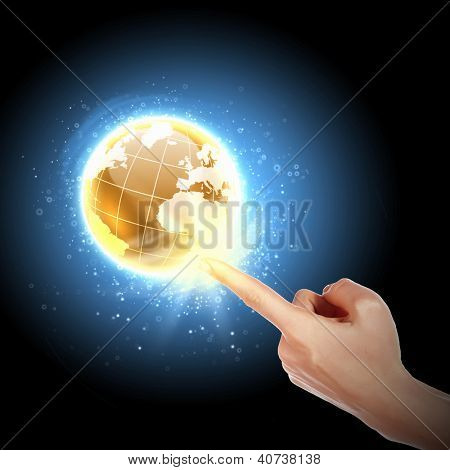 Human hand holding our planet earth glowing