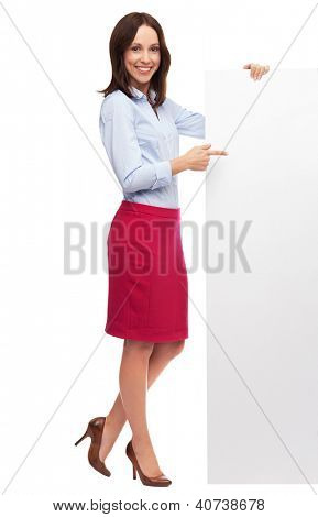 Beautiful woman pointing at blank board