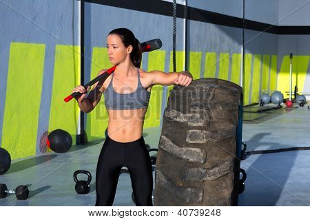sledge hammer woman workout at gym relaxed after exercise