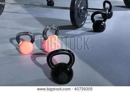Kettlebells at gym with lifting bar in background