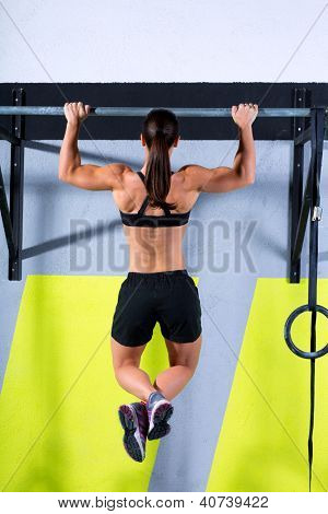 toes to bar woman pull-ups 2 bars workout exercise at gym