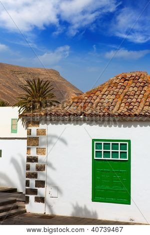 Lanzarote Yaiza white village houses green window in Canary Islands