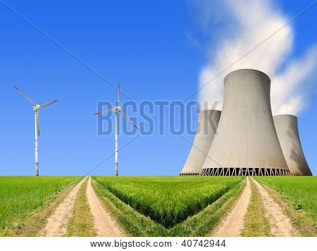 field way with nuclear power plant and wind turbines