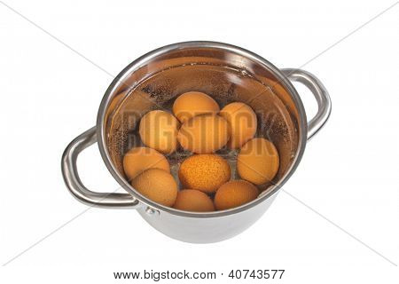 pan with cooking eggs, isolated on the white