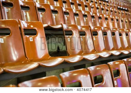 Rows Of Seats With Broken One