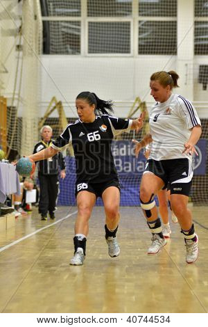 SIOFOK, HUNGARY - JANUARY 5: Nikolett Varga (black 66) in action at a Hungarian National Championship handball match Siofok KC (black) vs. Budapest SE (white) January 5, 2013 in Siofok, Hungary.