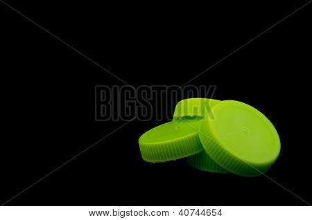 Pile Of Green Bottle Caps