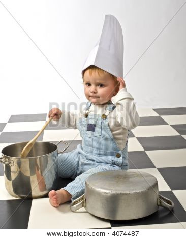 Little Boy Playing With Pots
