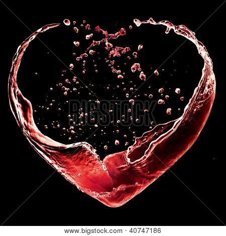 Valentine day heart made of red wine splash isolated on black background