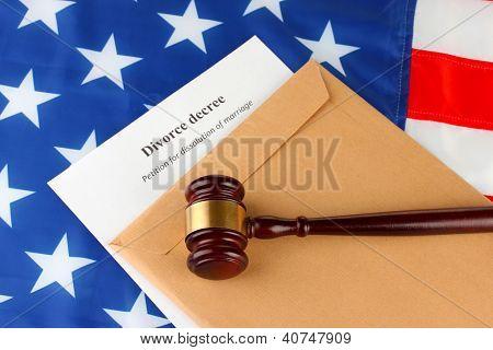 Divorce decree and envelope on american flag background