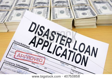 Approved disaster loan application form and dollar bills at cashier's desk