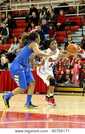 JAMAICA, NY-JAN 2: St. John's Red Storm guard Aliyyah Handford (3) drives to the net around Delaware Blue Hens guard Jaquetta May (3) at Carnesecca Arena on January 2, 2013 in Jamaica, New York.