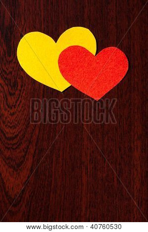 two hearts on a wooden background