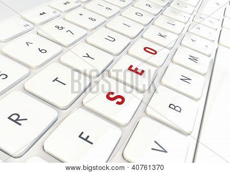 Seo Concept - Word Written On White Shiny Keyboard