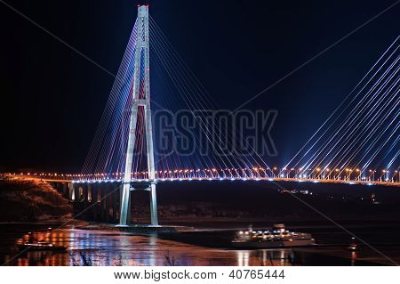 Night View Of The Longest Cable-stayed Bridge In The World In The Russian Vladivostok Over The Easte