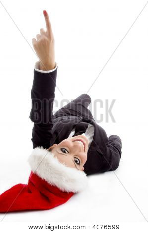 Executive With Christmas Hat Pointing Upward