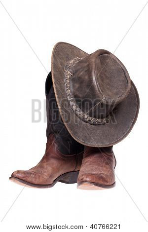 Leather cowboy boots and hat isolated on the white background with clipping path.
