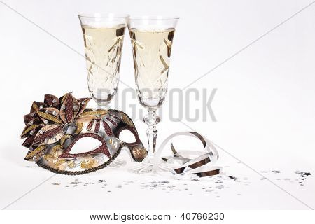 Masquerade mask and champagne isolated on white background.