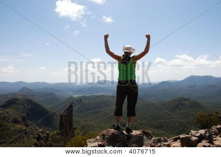 Girl Happy On Top Of A Rock Overlooking A Valley