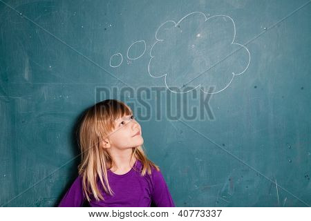 Young Girl And Idea Bubble On Chalkboard