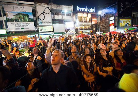 CHIANGMAI,THAILAND - DEC 31: People gathered in the city center on the countdown during the New Year celebrations, Dec 31, 2012 in Chiangmai, Thailand. Thai official calendar now is 2555 year.