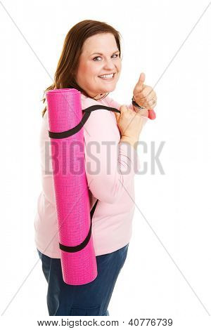 Pretty, overweight woman going to work out with her yoga mat.  Isolated on white.