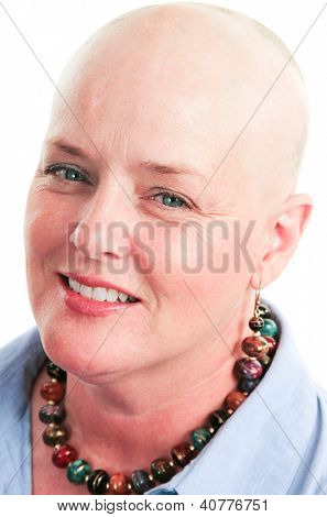 Closeup portrait of beautiful cancer survivor who has lost her hair due to chemotherapy.