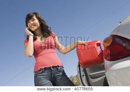 Woman refueling car