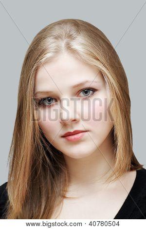 Nice Girl With Long Hair On Gray