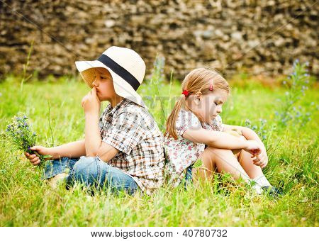 Little Boy And Little Girl Near The Country House