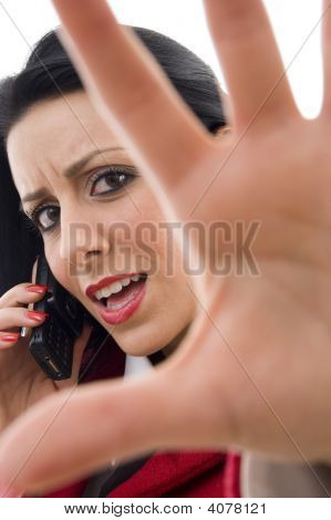 Female Interacting On Cell Phone Showing Stopping Gesture