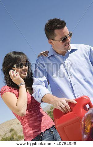 Couple refueling car