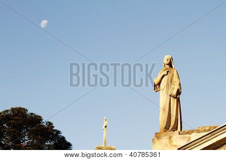 Statue In The Cemetery Of Recoleta With The Moon In The Background