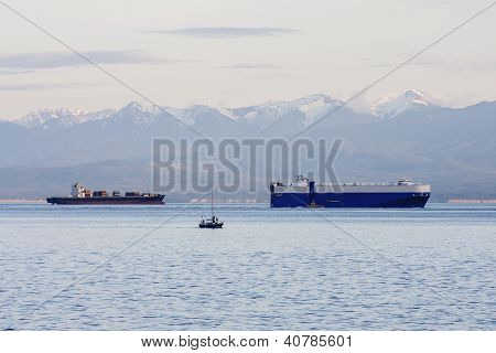 Freighters By Blue Snow Capped Mountains