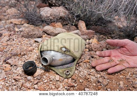 A hiker in the extreme wilderness succumbs to dehydration while in the remote desert, indicated by an old, empty canteen.