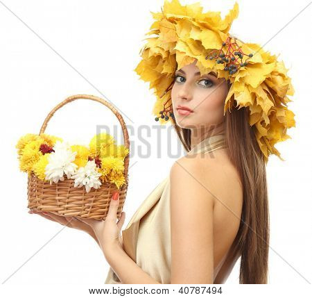 beautiful young woman with yellow autumn wreath and basket with flowers, isolated on white