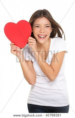 Woman showing heart. Love and valentines day concept with joyful mixed race Chinese Asian / Caucasian young woman smiling cheerful isolated on white background.