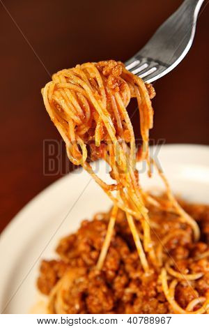 A picture of fresh spaghetti served on a white plate