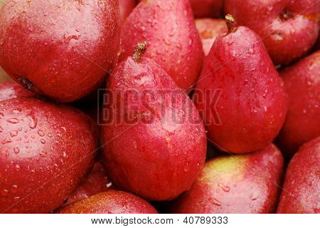 Pile of red pears at the farmers market on a rainy day