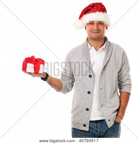 Young caucasian handsome man in christmas hat isolated over white background