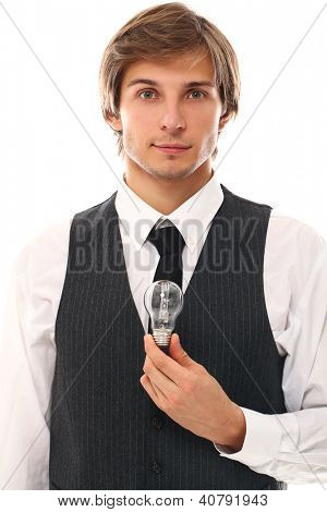 Handsome businessman holding lamp in a hand