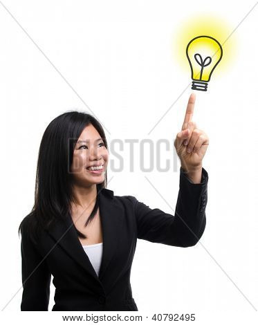 Southeast Asian woman hand pointing at  light bulb idea over white background