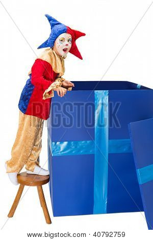Little jester clown looking into a big blue surprise box