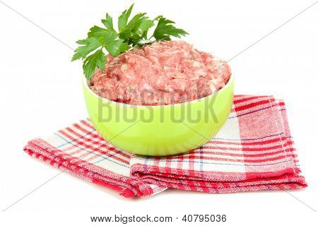 Bowl of raw ground meat isolated on white